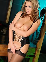 Jodie Gasson shows she has a real naughty streak as she poses in her latex corset, stockings and high heels.