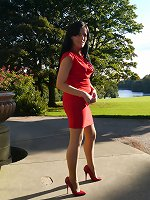 Sexy Tricia takes a stroll outdoors wearing a tight red dress with matching high heel shoes and handbag