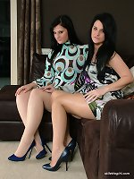 Two hot babes play with each others blue spiked heels