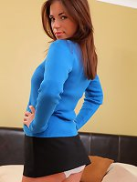 Naughty college girl looks gorgeous in her revealing uniform, tight sweater and heels.