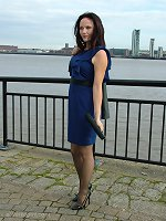 Cute Carrie is outdoors in a lovely blue dress with a pair of seamed stockings and a pair of killer stiletto heels on
