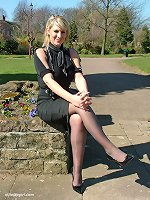 Gorgeous blonde Demi catches some sun out and about, wearing a pretty black blouse and skirt, with matching tall stilettos