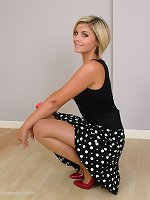 Gorgeous blonde heel lover Naomi shows her sexy legs and stilettos around the house