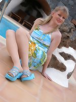 Angel at swimming pool in seamless suntan pantyhose