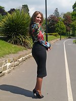 Hot brunette Debbie shows her nice arse in a tight skirt and tall black stiletto heels